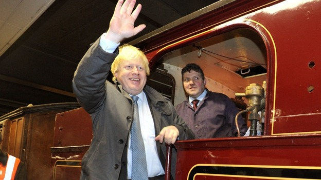 Boris Johnson, the Mayor of London, waves from aboard the 115-year-old train.