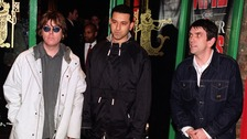 (L-R) Mike Joyce, former Smiths drummer, Aziz Ibrahim, former Stone Roses guitarist, and Andy Rourke former Smiths bassist.