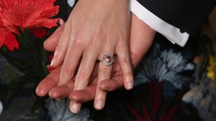 Princess Eugenie wears a ring containing a padparadscha sapphire surrounded by diamonds.