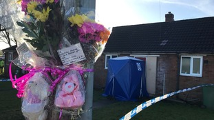 Flowers and teddies left at the house where Mylee died.
