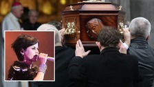 Dolores O'Riordan's coffin is carried into St Joseph's Church in Co Limerick.