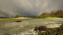 Snow shower over Stanton Moor