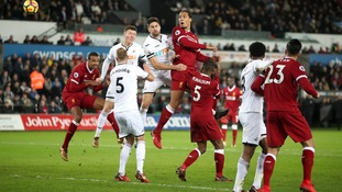 Swansea City celebrates after a sensational 1-0 victory against Liverpool