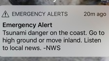US tsunami warning downgraded after earthquake