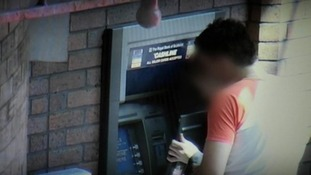 Gangs insert hidden cameras and information stealing devices into ATM machines.