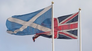 The flag of St Andrew and the Union flag.