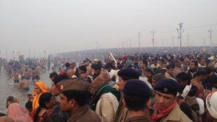 Crowds cover the banks of the Ganges as the Kumbh Mela begins