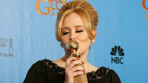 Adele celebrating her Golden Globe win for Skyfall