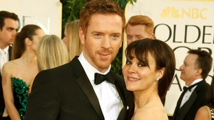 Actor Damian Lewis and his wife Helen McCrory arrive at the Golden Globes