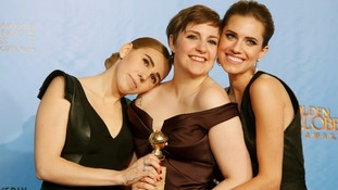Girls creator and actress Lena Dunham poses with cast members Allison Williams and Zosia Mame