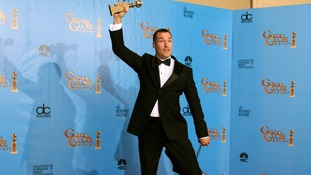 Director Mark Andrews jumps for joy after his  Best Animated Feature Film win for Brave