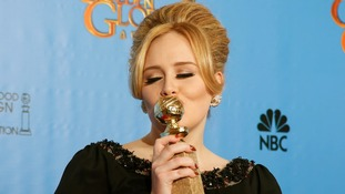 Adele celebrates her Golden Globe win for Skyfall