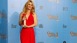 Claire Danes, winner for Best Actress in a Television Series, Drama for Homeland wore a full length bright red dress