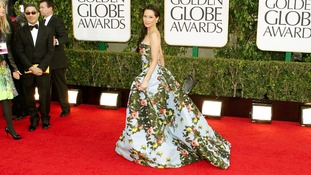 Actress Lucy Liu arrives in a floral gown