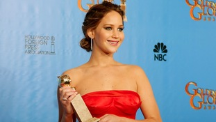 Jennifer Lawrence smiles after her Golden Globes win for Best Actress