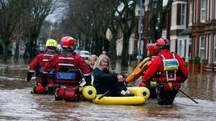 Emergency workers rescue two women from floodwater on Warwick Road, Carlisle