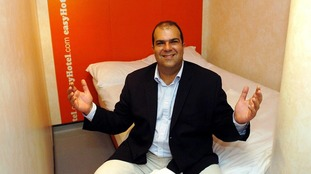 EasyJet founder Stelios Haji-Ioannou, in a bedroom of his first easyHotel.