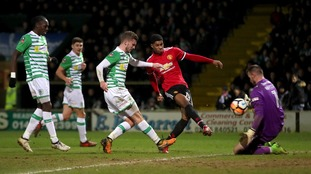 Manchester United's Marcus Rashford (second right) scores his side's first goal of the game during the Emirates FA Cup, fourth round match at Huish Park, Yeovil.