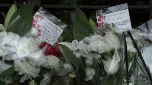 Flowers and cards left by family members of the victims.
