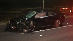 The black Audi car involved in the accident.
