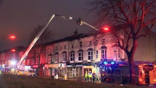 Busy Birmingham road remains closed after fire destroys old motorcycle shop