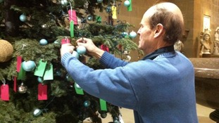 Philip Bowmer, helping take down the last of the festive decorations.