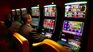 Man using gambling machine
