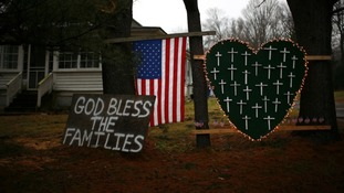 Tributes left close to Sandy Hook Elementary School in Connecticut where 26 people were shot dead