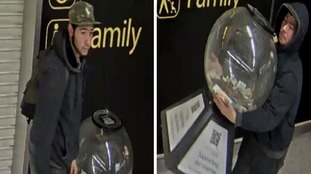 Pair of brazen thieves carry off globe full of charity cash