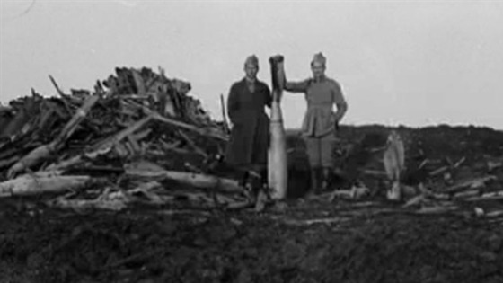 Orlov's favourite image, showing two men posing with a WW1 bomb