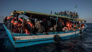 A boat leaving Libya on 27 January 2018. Libya has for years been a major transit route for migrants trying to reach southern Europe by sea.