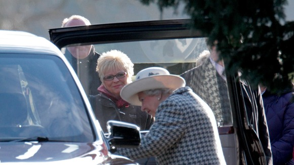 The Queen looks on as her Bentley struggles to start