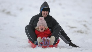 Luke Kent and Darcie-Mae Montgomerie from Leicester sledge at Bradgate Park, Leicestershire