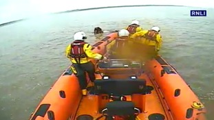 Coastguards save woman trapped on car roof at high tide