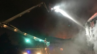 100 firefighters spend night tackling Rochdale fire