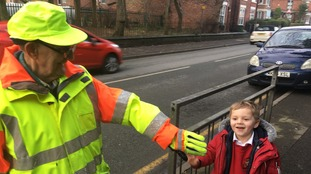 Children banned from high-fiving their lollipop man because it's 'causing a disruption'