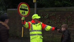 Council lifts ban on lollipop man giving children high-fives
