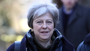 Speculation of powersharing deal as Theresa May heads to Belfast