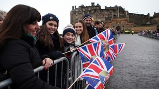 Crowds gathered in Edinburgh ahead of the couple's arrival.
