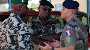A French Army officer talks to his Malian and Senegalese army counterparts in Bamako, Mali