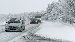 Traffic makes its way slowly along the road at Hole of Horcum on the North Yorkshire Moors.