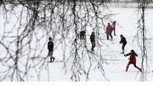 File photo of children having a snowball fight.