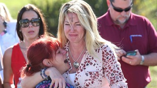 Two women console each other in Florida.