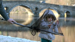 Two year old Kiera Gowan from Pitlochry plays with a fishing landing net at Kenmore on the river Tay