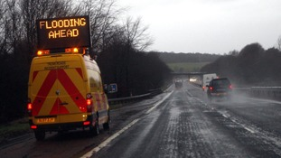 A flooding warning sign on the M80 in Scotland.