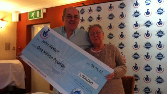 John and Carol Baxter from Baldock with their cheque