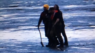 Emergency services were able to free the boy and get him safely back to shore