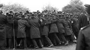 File photo dated 01/06/1984 of police officers pushing against striking miners outside the Orgreave