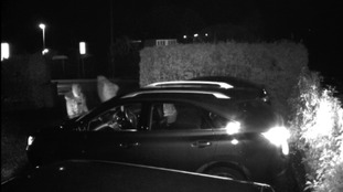 The thieves gain entry to the car