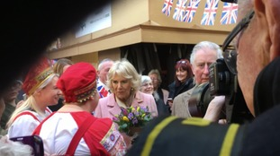 Camilla, Duchess of Cornwall, receives flowers from the crowd